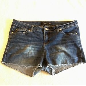 Torrid cut off medium wash jean shorts 18